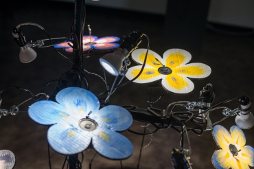 "Close up of ""Tone Flowers"", showing assembled electronics package and photoresistor 'stamen'. Photo by Maxwell Brisben https://maxwellbrisben.smugmug.com/"